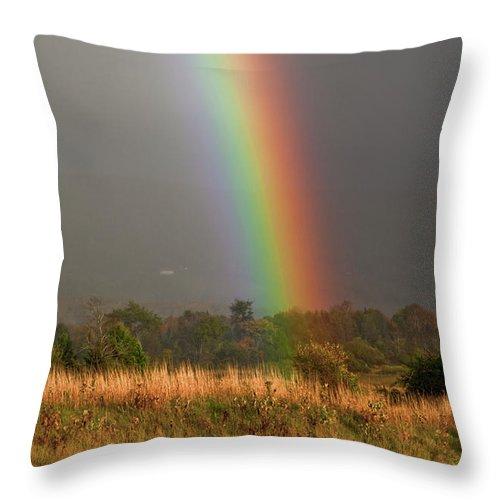 Rainbow Throw Pillow featuring the photograph Rainbow by Trevor Slauenwhite
