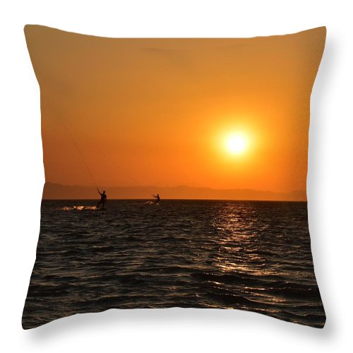 Kitesurfing Throw Pillow featuring the photograph Red sea sunset by Luca Lautenschlaeger
