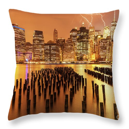 Lightning Storm Throw Pillow featuring the photograph Lightening Strikes Over New York Skyline by Neale And Judith Clark