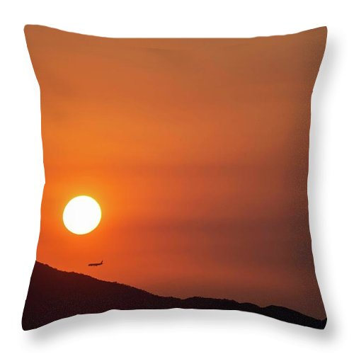Sunset Throw Pillow featuring the photograph Red sunset and plane in flight by Hannes Roeckel