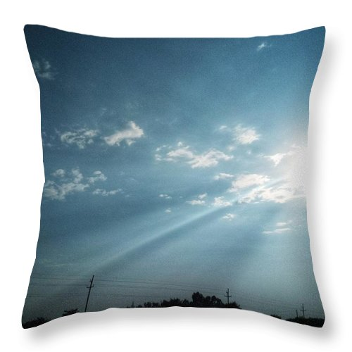 Sky Throw Pillow featuring the photograph Striking rays by Yvonne's Ogolla