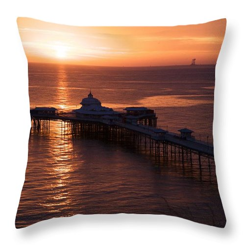 Piers Throw Pillow featuring the photograph Sunrise over Llandudno pier 2 by Christopher Rowlands