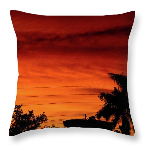 Sunset Throw Pillow featuring the photograph The Fire sky by Daniel Cornell