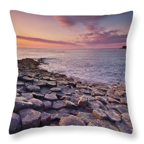 Giants Causeway Throw Pillow featuring the photograph The Giants Causeway Sunset, Northern Ireland by Neale And Judith Clark
