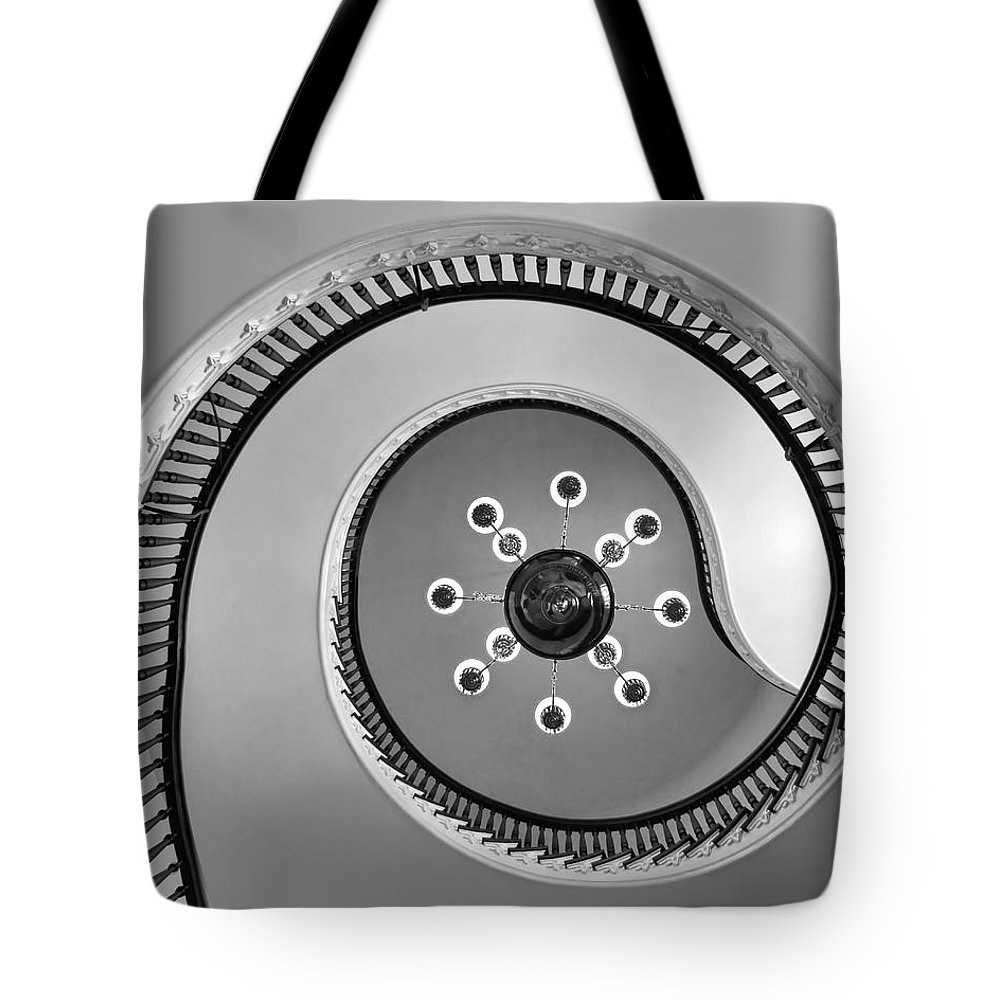 Spiral Staircases Tote Bag featuring the photograph @ - Bw by Nikolyn McDonald