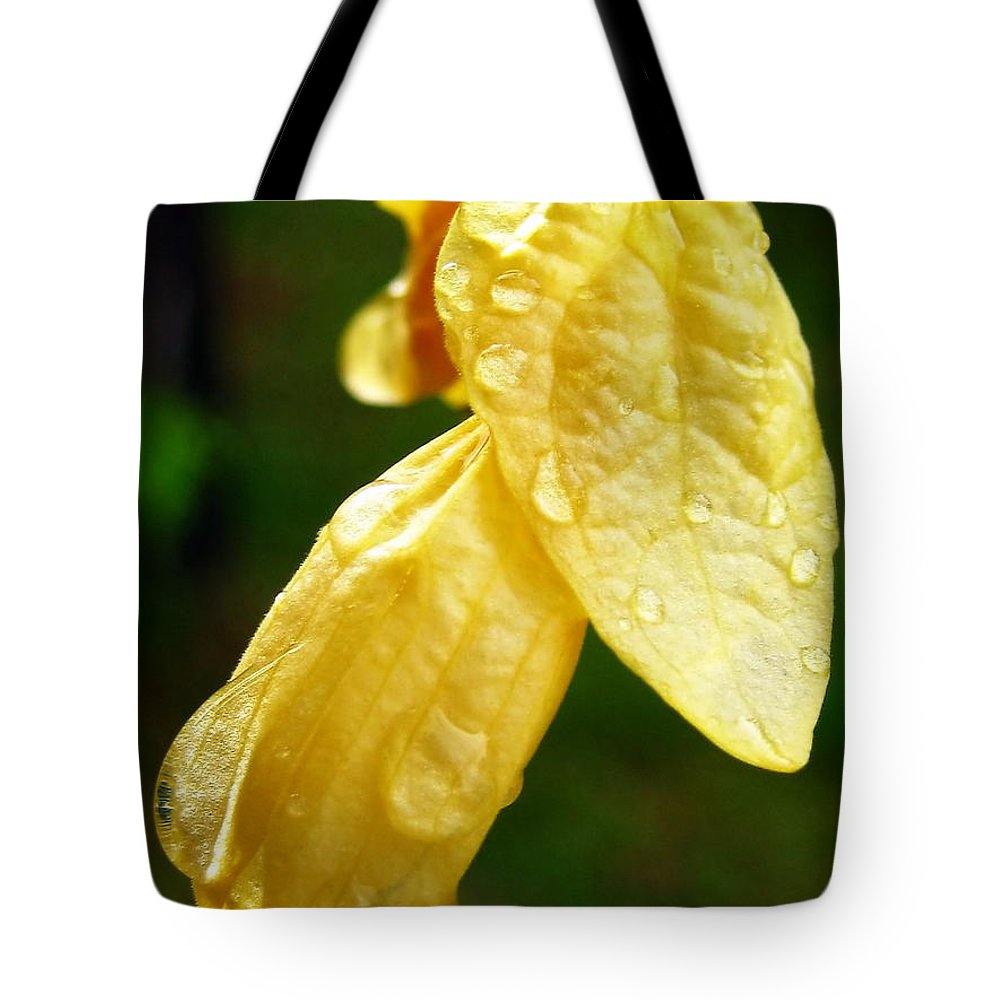 Raindrops Tote Bag featuring the photograph Drop On Yellow Flower by Michelle Meenawong