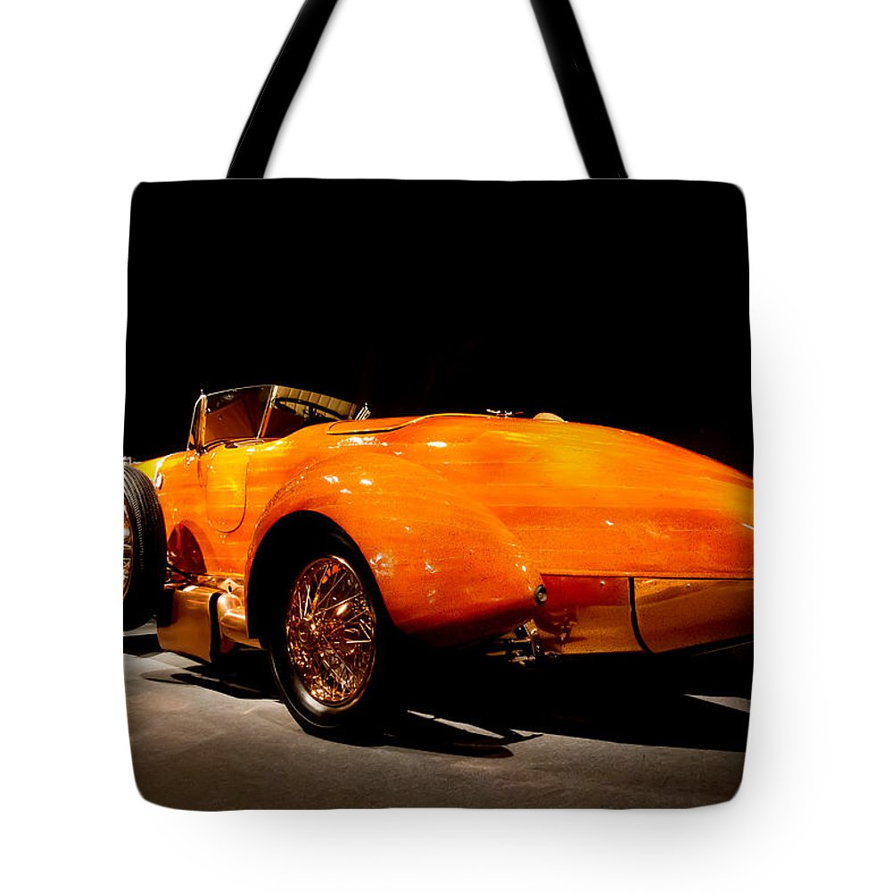 1924 Hispano-suiza Tulipwood Torpedo Tote Bag featuring the photograph 1924 Hispano Suiza Torpedo by Roger Mullenhour