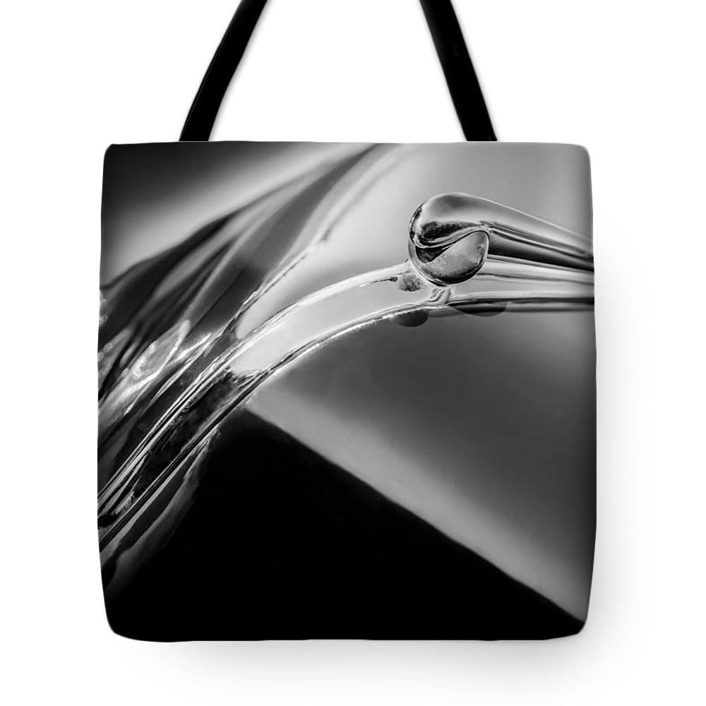 1941 Lincoln Contitnental Convertible Hood Ornament Tote Bag featuring the photograph 1941 Lincoln Contitnental Convertible Hood Ornament - Grille Emblem -0438bw by Jill Reger
