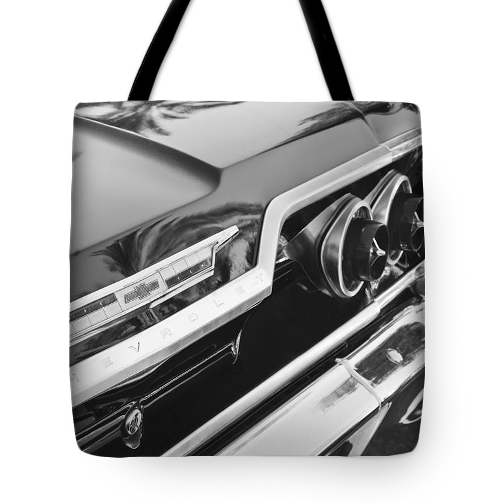 1963 Chevrolet Taillight Emblem Tote Bag featuring the photograph 1963 Chevrolet Taillight Emblem by Jill Reger