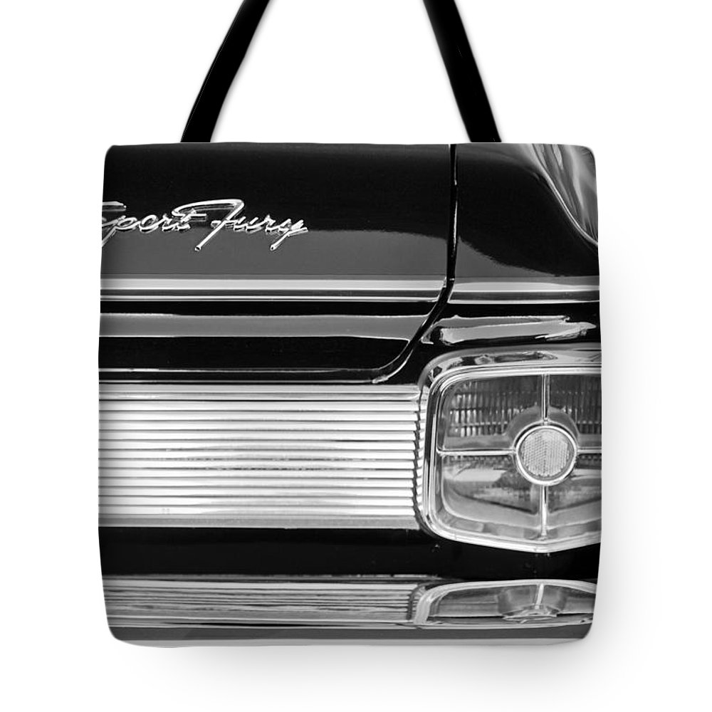 1963 Plymouth Sport Fury Taillight Emblem Tote Bag featuring the photograph 1963 Plymouth Sport Fury Taillight Emblem by Jill Reger