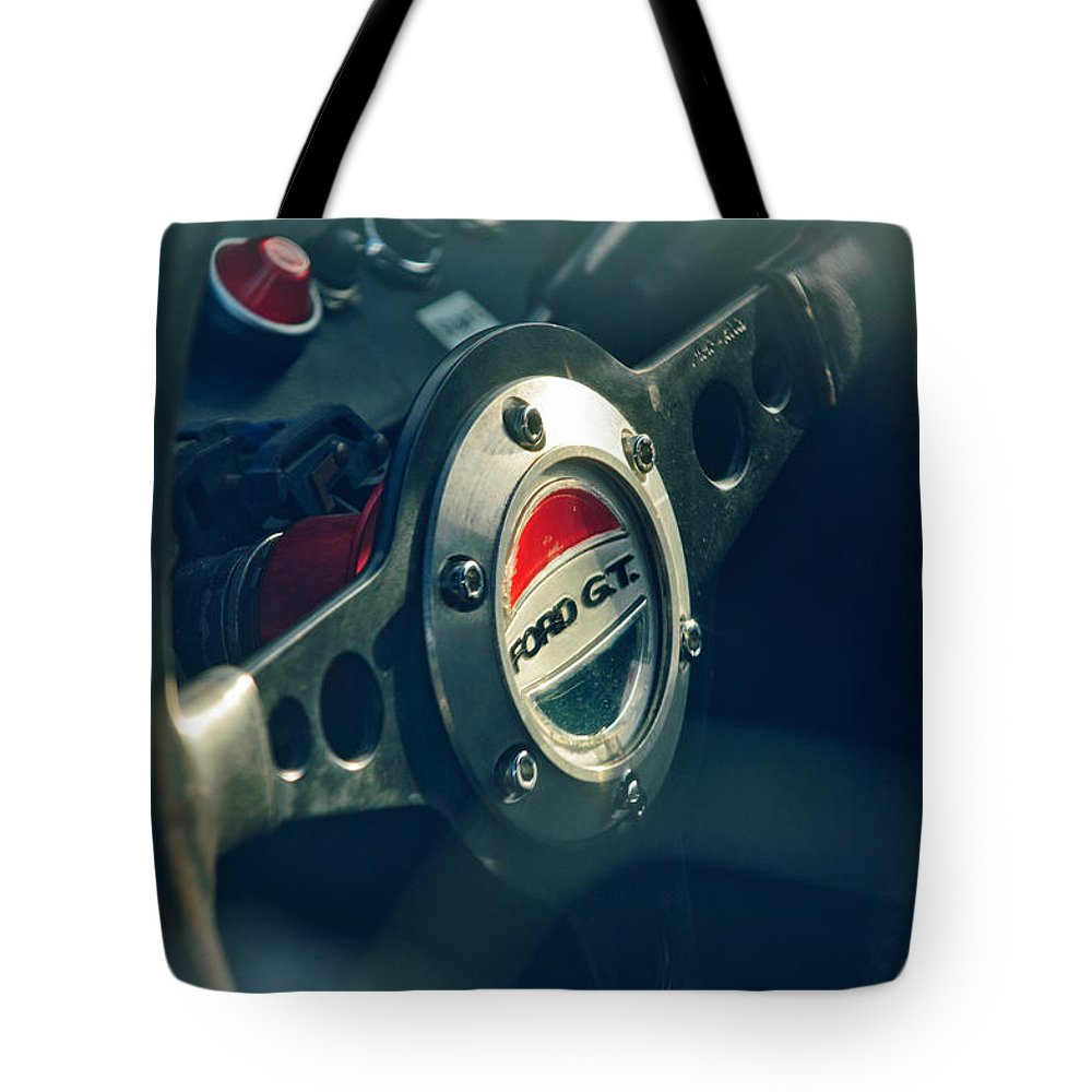 1965 Ford Gt 40 Steering Wheel Emblem Tote Bag featuring the photograph 1965 Ford Gt 40 Steering Wheel Emblem by Jill Reger