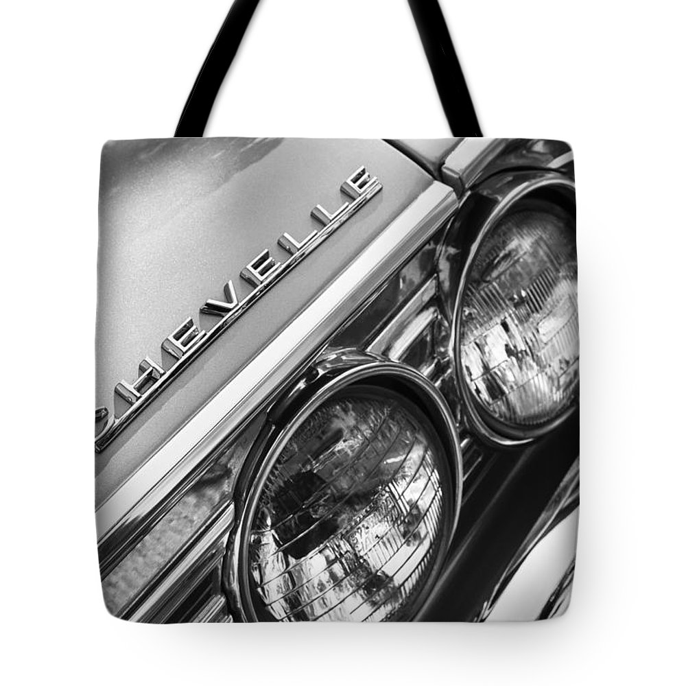 1967 Chevrolet Chevelle Malibu Head Light Emblem Tote Bag featuring the photograph 1967 Chevrolet Chevelle Malibu Head Light Emblem by Jill Reger