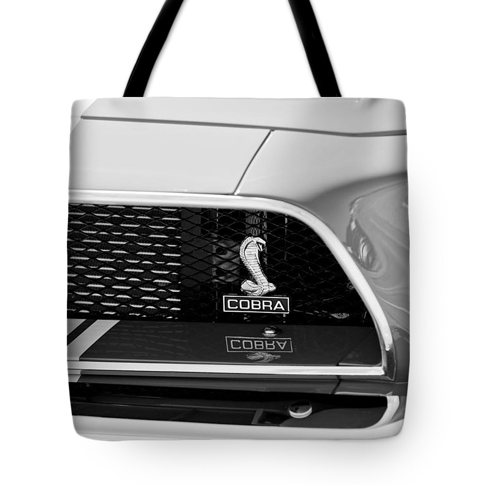 1968 Ford Mustang 427 Ci Fastback Grille Emblem Tote Bag featuring the photograph 1968 Ford Mustang 427 Ci Fastback Grille Emblem by Jill Reger