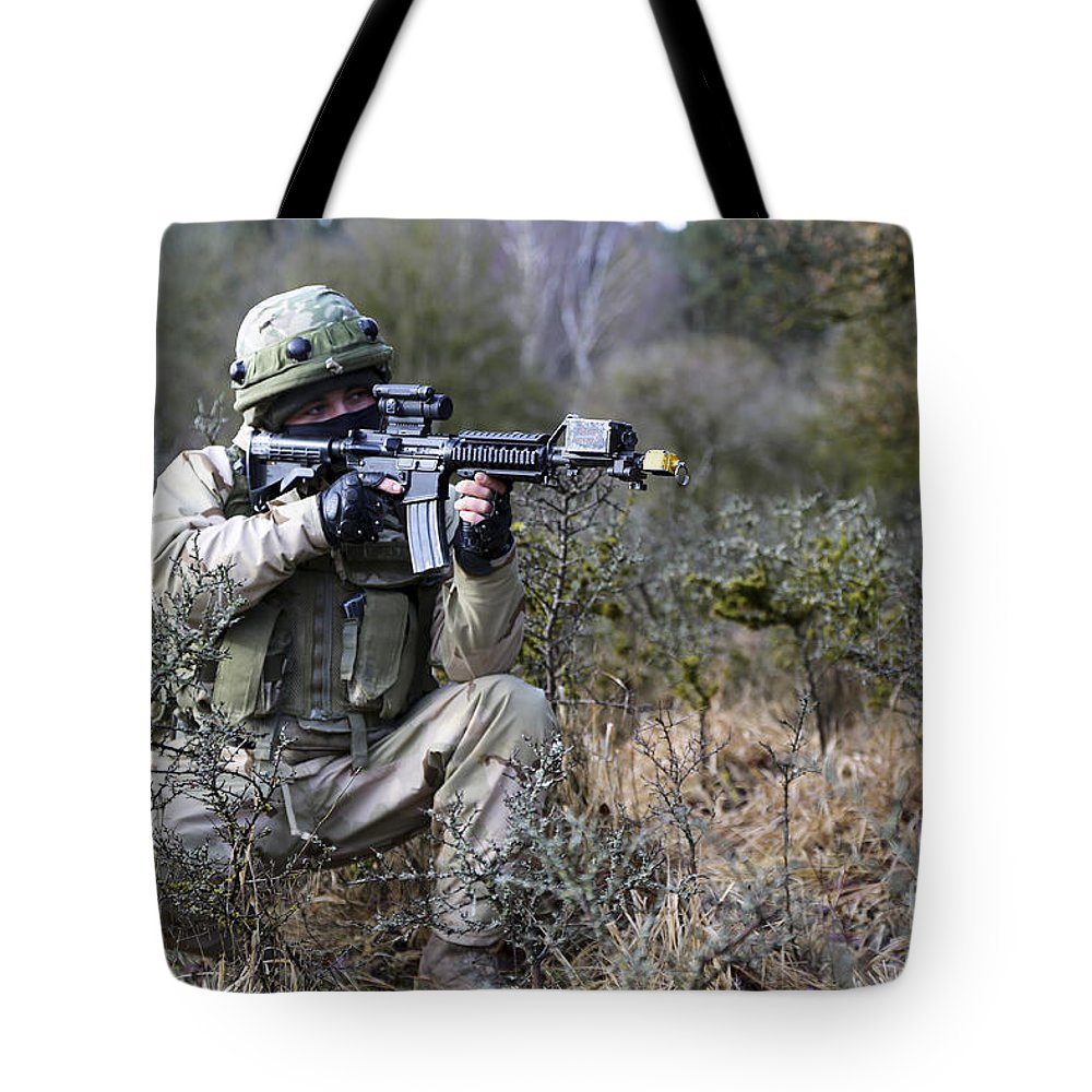 M4 Carbine Tote Bag featuring the photograph A Georgian Soldier Provides Security by Stocktrek Images