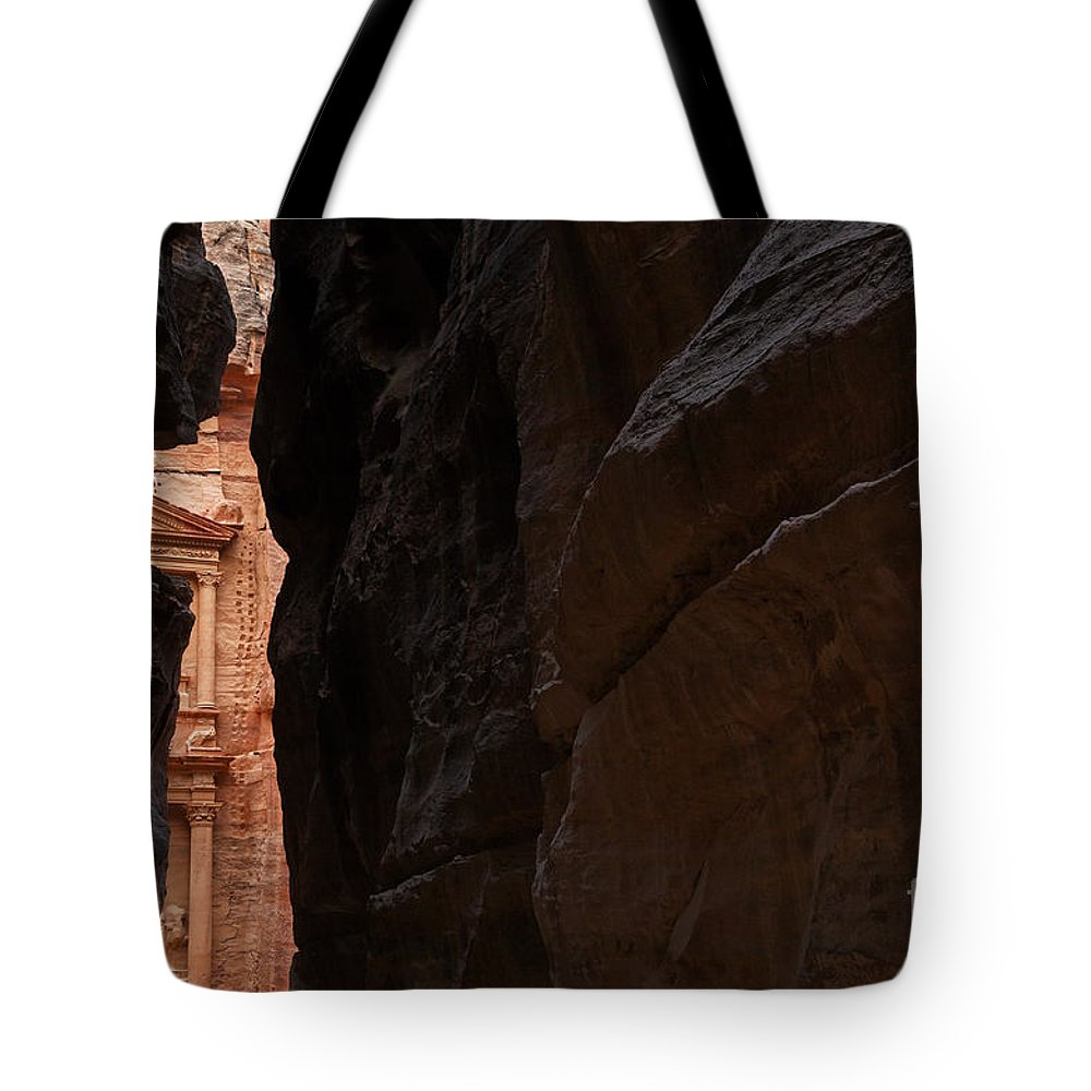 Treasury Tote Bag featuring the photograph A Glimpse Of Al Khazneh From The Siq In Petra Jordan by Robert Preston