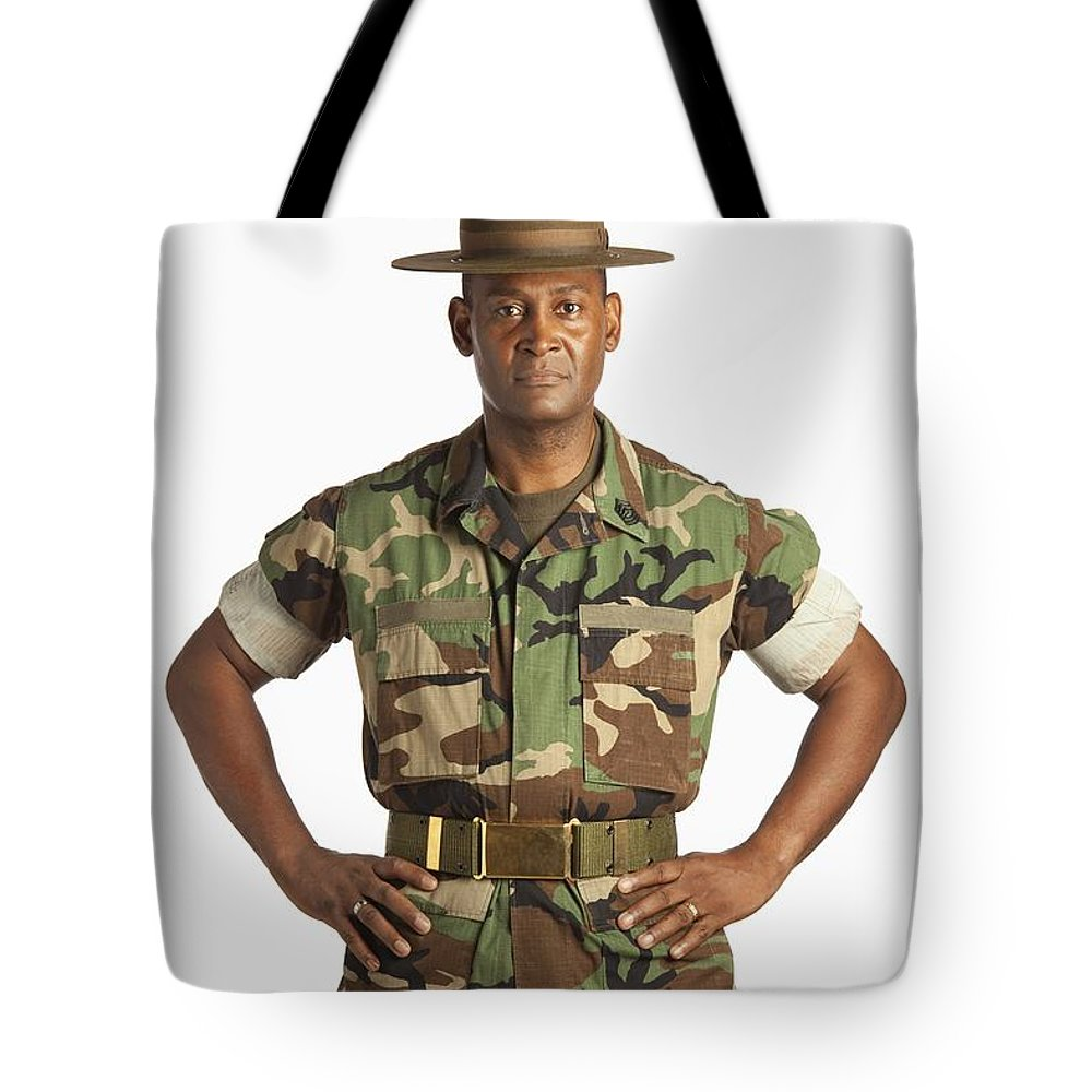 Us Marines Tote Bag featuring the photograph A Military Man by Ron Nickel