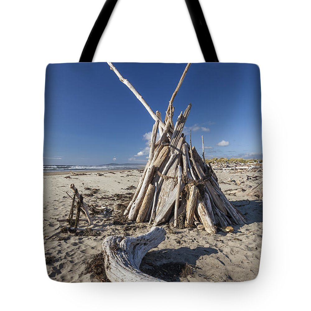 Bandon Tote Bag featuring the photograph A Teepee Madeup Of Driftwood At Bandon Beach by Bryan Mullennix