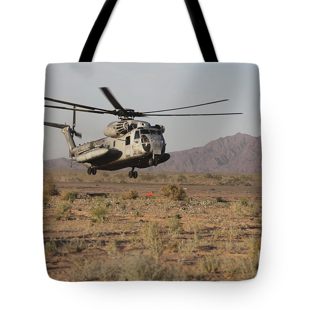 Ch-53 Sea Stallion Tote Bag featuring the photograph A U.s. Marine Corps Ch-53 Sea Stallion by Stocktrek Images
