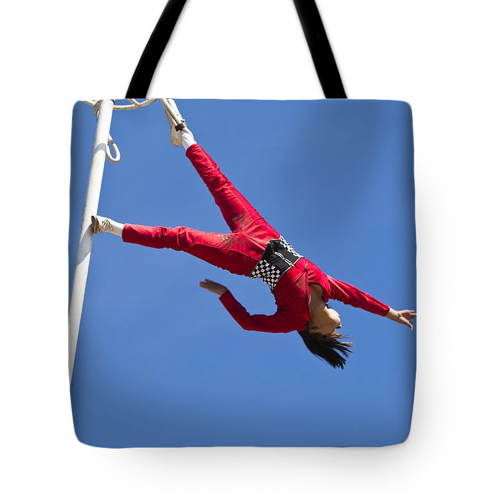 Daredevil Tote Bag featuring the photograph Acrobatic Performance by Ohad Shahar