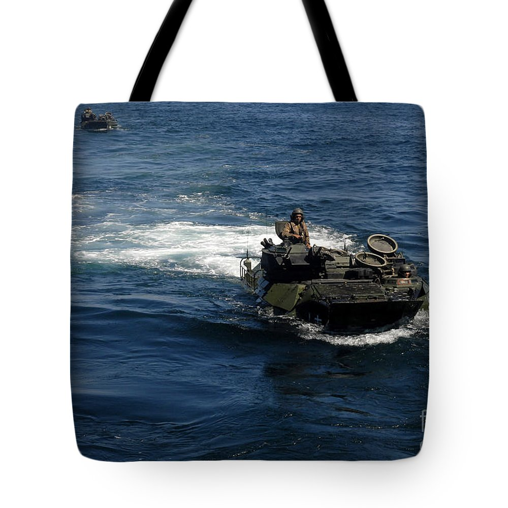 Military Tote Bag featuring the photograph Amphibious Assault Vehicles Transit by Stocktrek Images