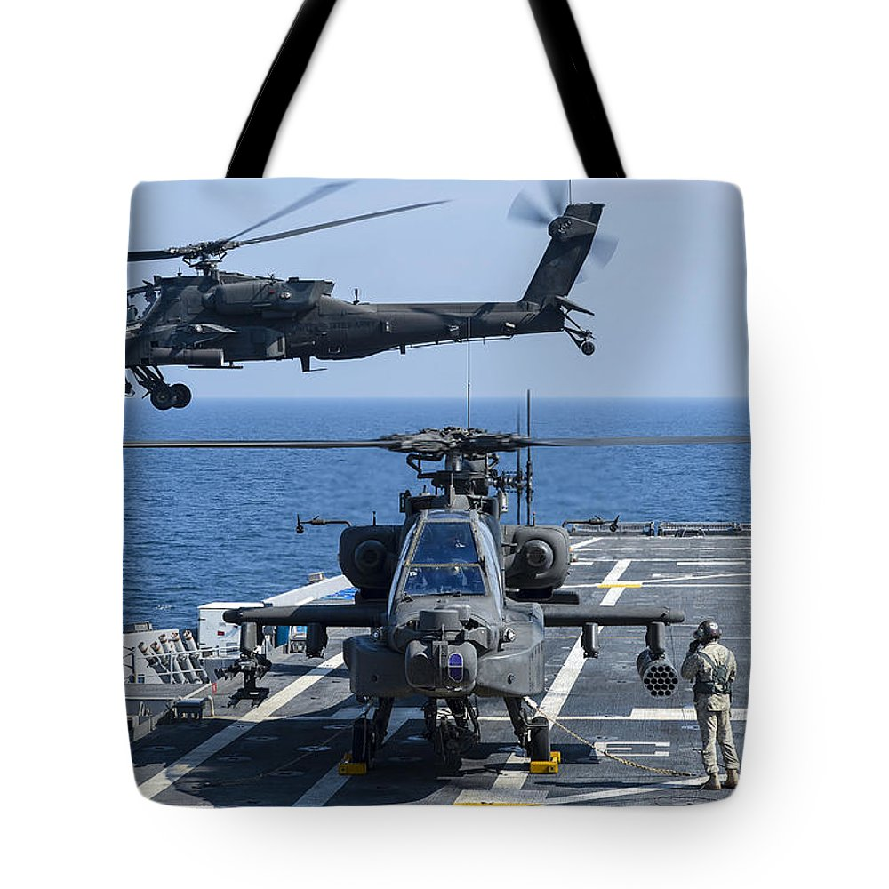 Military Tote Bag featuring the photograph An Army Ah-64d Apache Helicopter Takes by Stocktrek Images