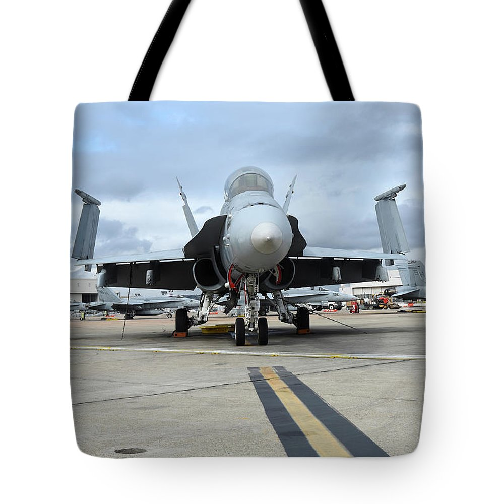 Marine Corps Air Station Miramar Tote Bag featuring the photograph An Fa-18d Hornet On The Ramp At Marine by Riccardo Niccoli