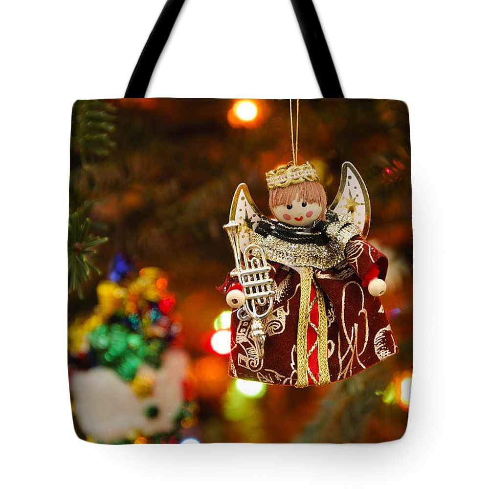 Blue Tote Bag featuring the photograph Angel Christmas Ornament by Oscar Gutierrez