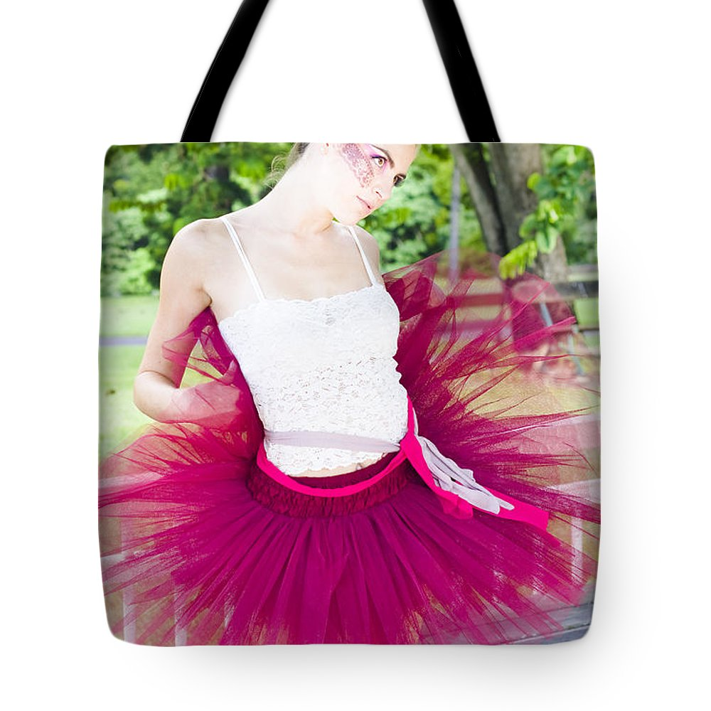 Attractive Tote Bag featuring the photograph Ballerina Stretching And Warming Up by Jorgo Photography - Wall Art Gallery