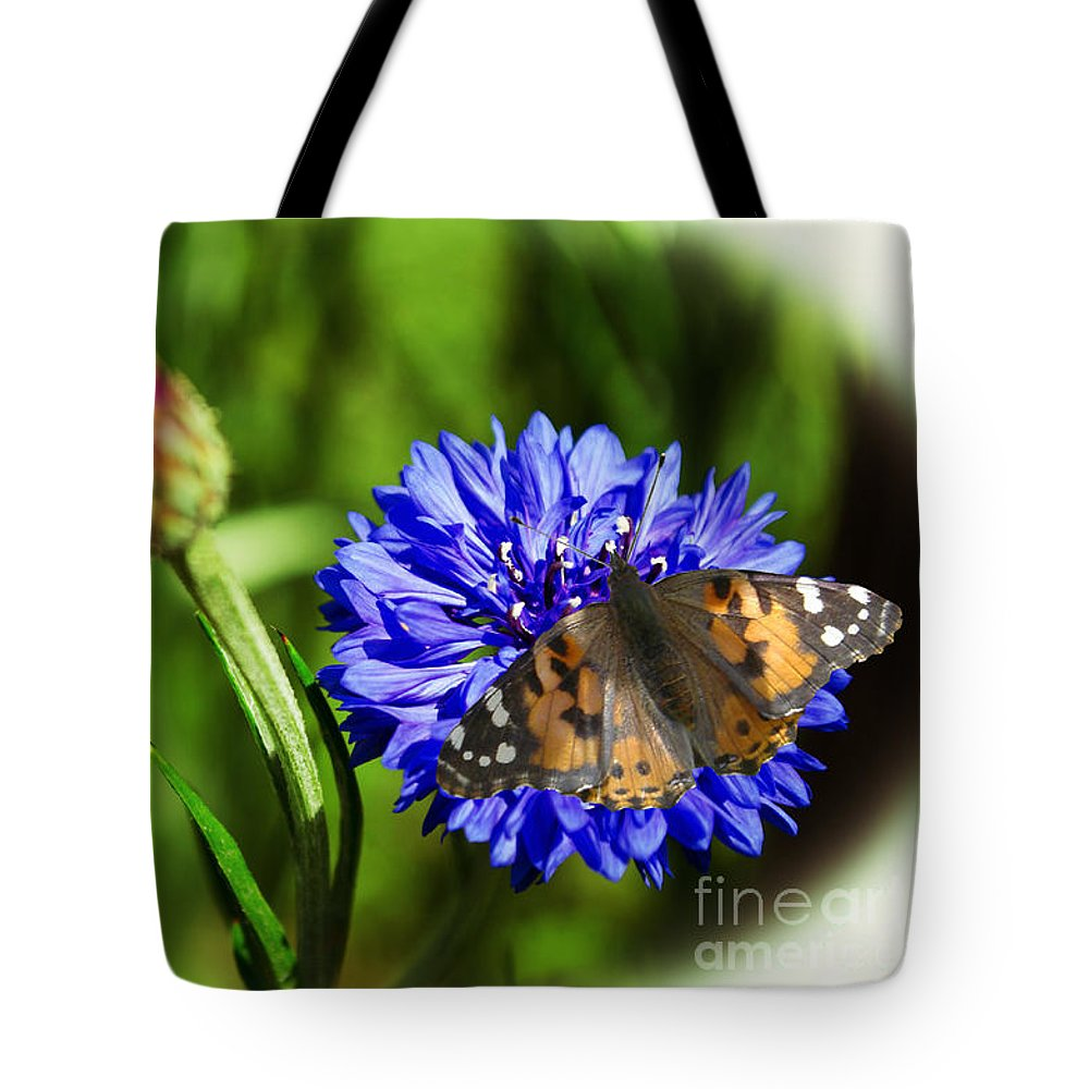 Flower Tote Bag featuring the photograph Beauty In The Eyes Of The Beholder by Donna Brown