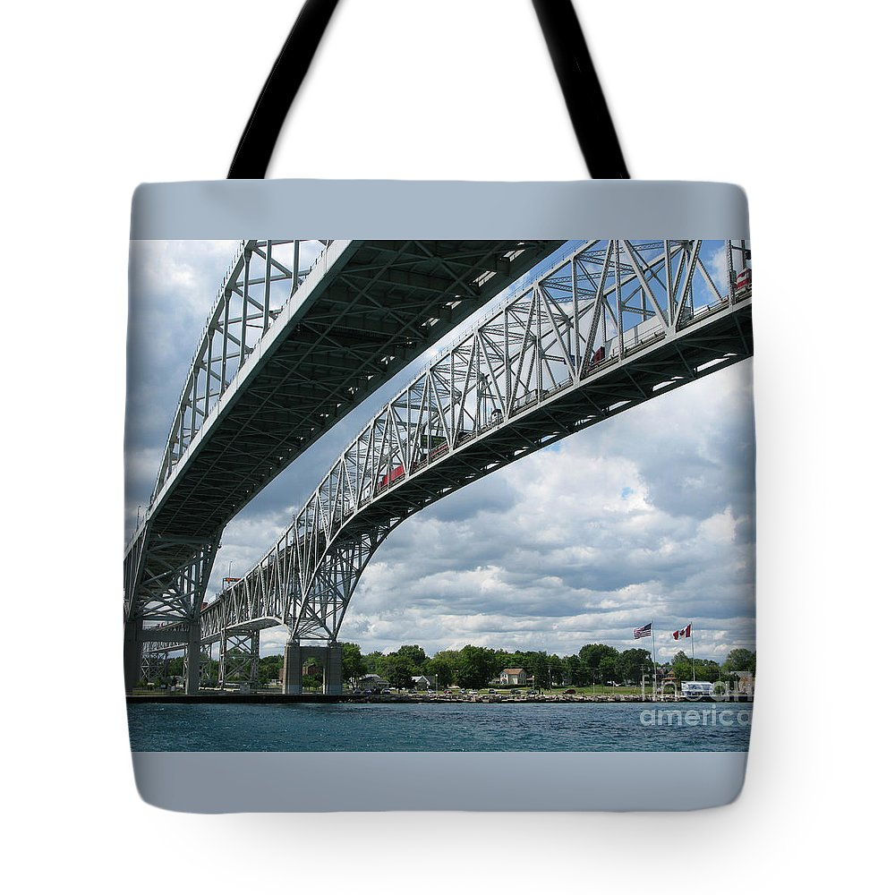 Bridge Tote Bag featuring the photograph Blue Water Crossing by Ann Horn
