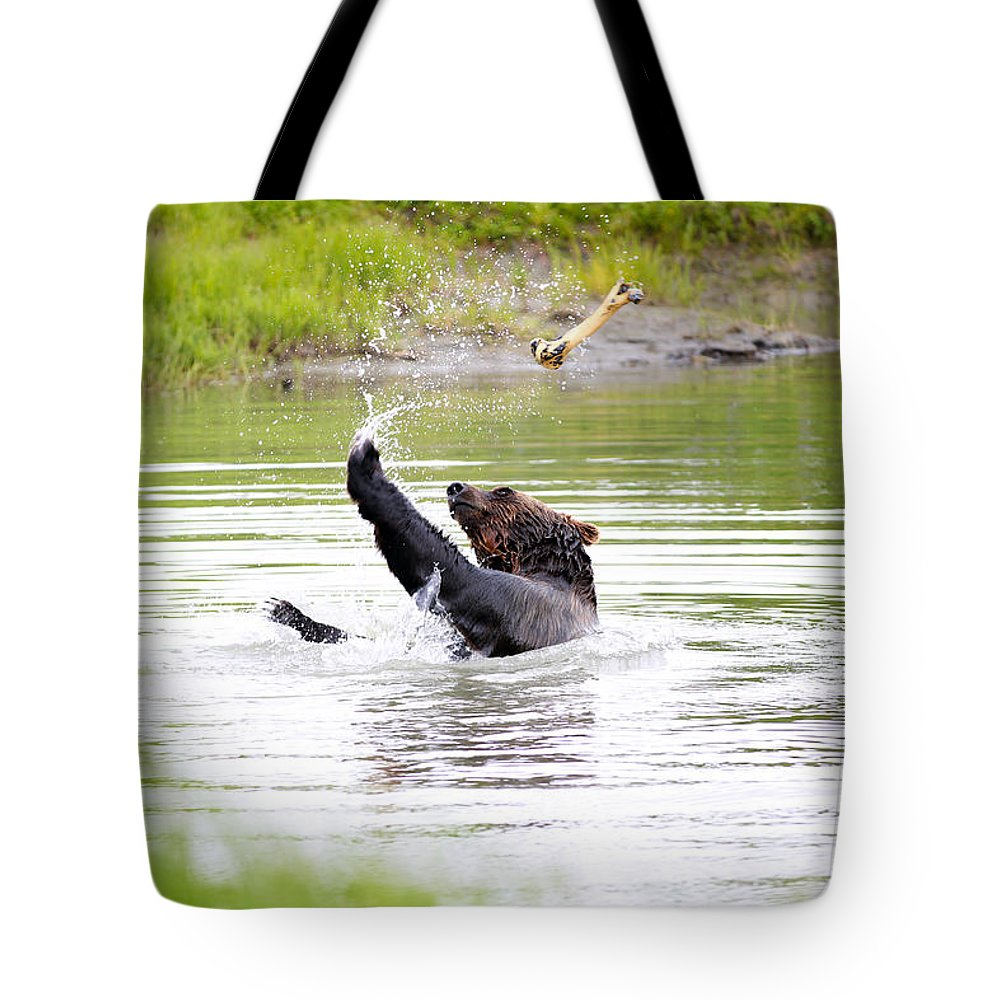 Animal Tote Bag featuring the photograph Brown Bear Playing With A Bone by Paul Fell