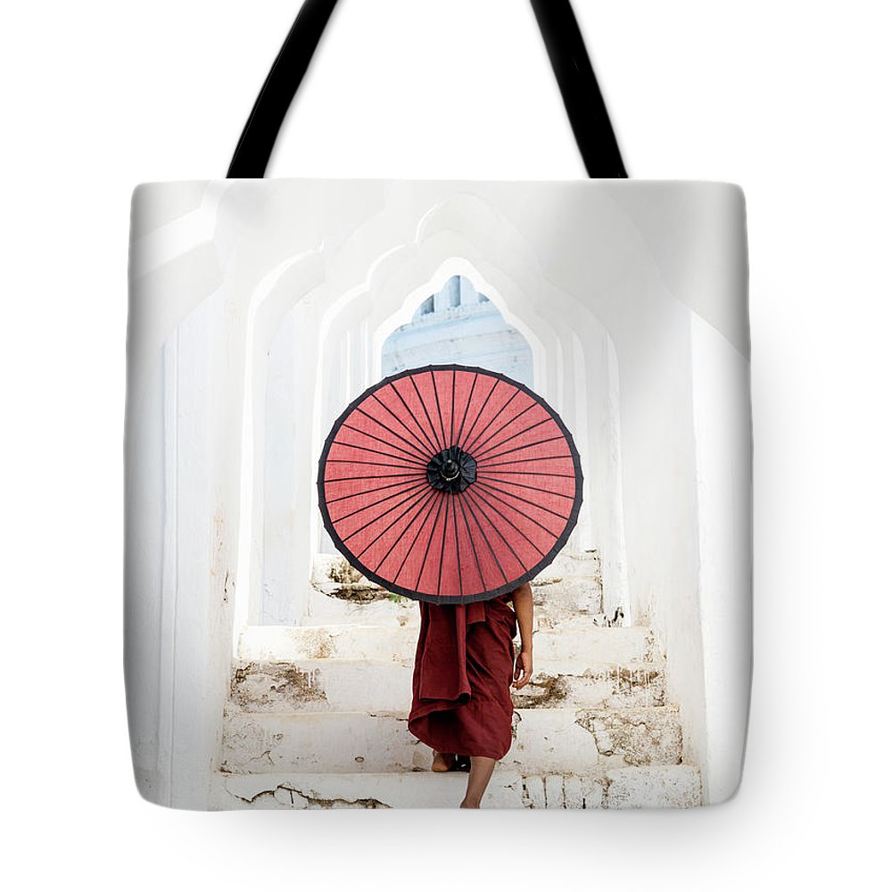Steps Tote Bag featuring the photograph Buddhist Monk Walking Along Temple by Martin Puddy