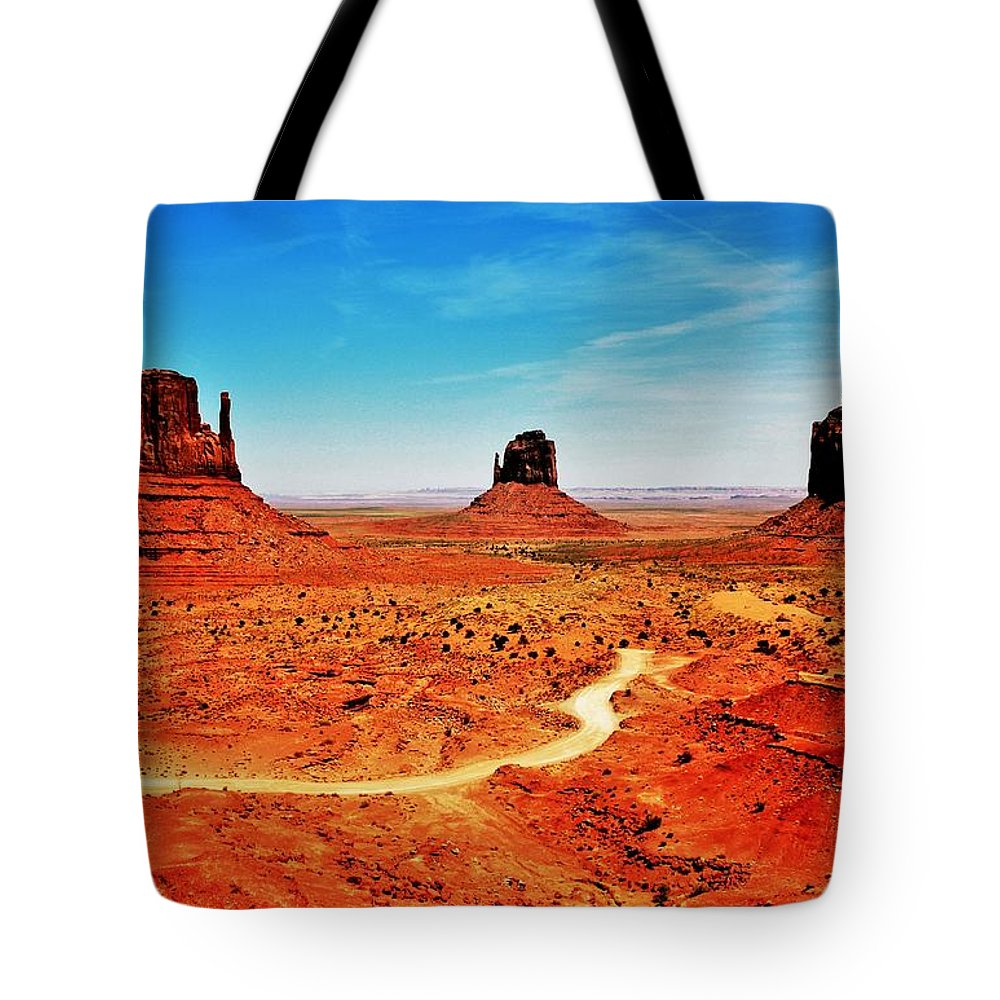 Monument Valley Tote Bag featuring the photograph Buttes by Benjamin Yeager