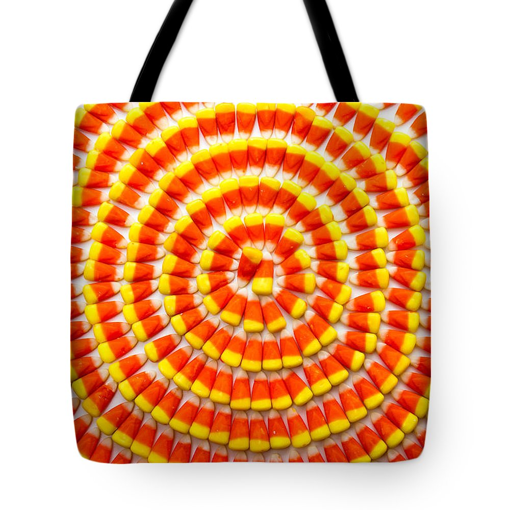 Arranged Tote Bag featuring the photograph Candy Corn In Circles by Teri Virbickis