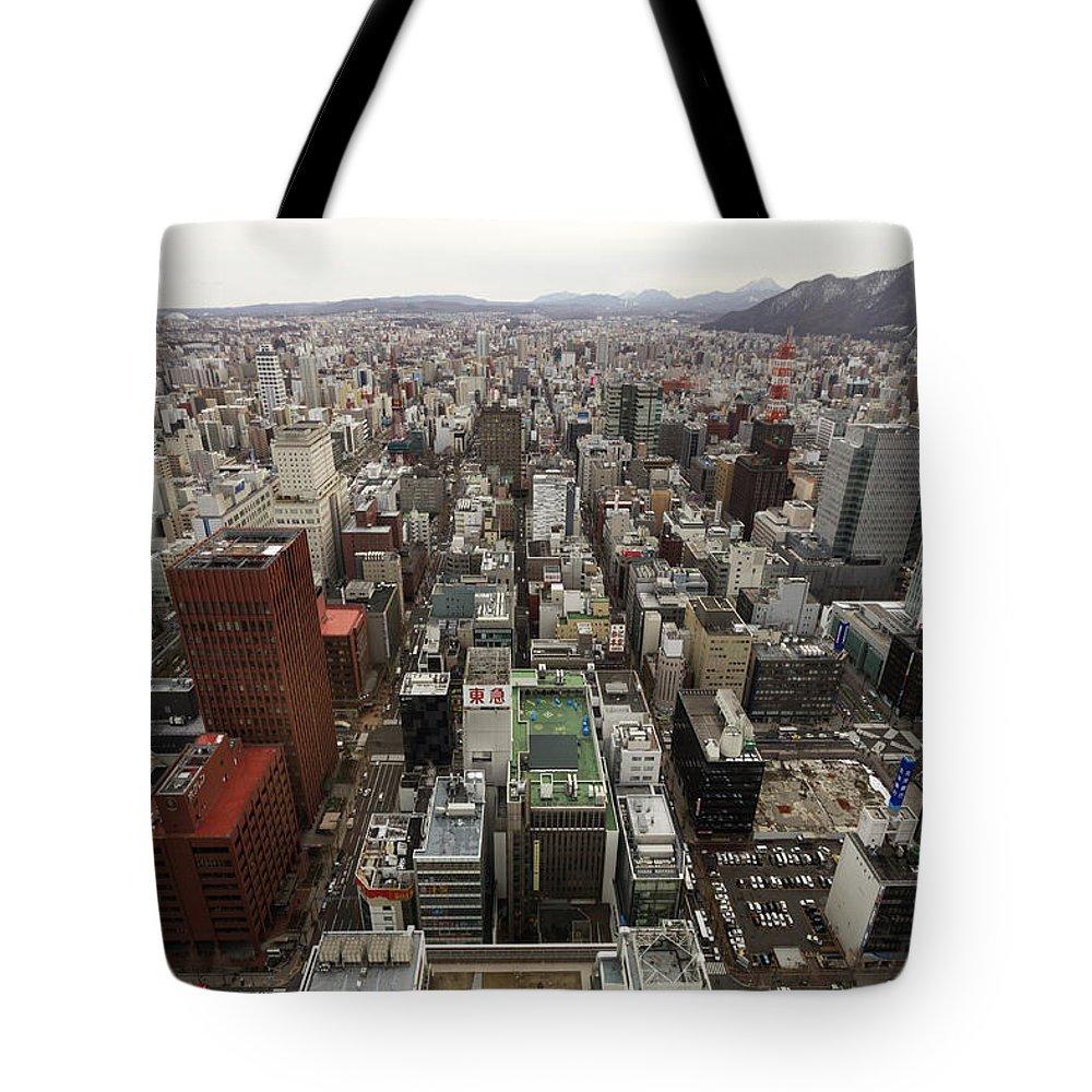 Hokkaido Tote Bag featuring the photograph Cityscape Of Sapporo, Hokkaido, Japan by Tetsuya Aoki