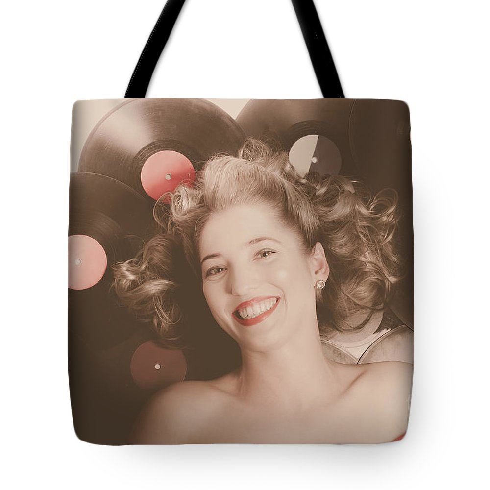 Girl Tote Bag featuring the photograph Classic Pin Up Girl On Vintage Vinyl Lp Records by Jorgo Photography - Wall Art Gallery