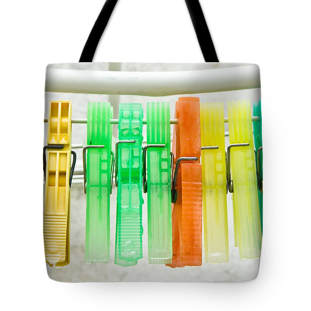 Backdrop Tote Bag featuring the photograph Clothes Pegs by Tom Gowanlock