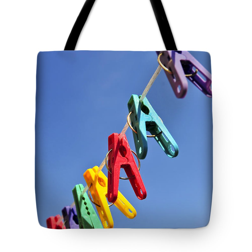 Clothes Tote Bag featuring the photograph Colorful Clothes Pins by Elena Elisseeva