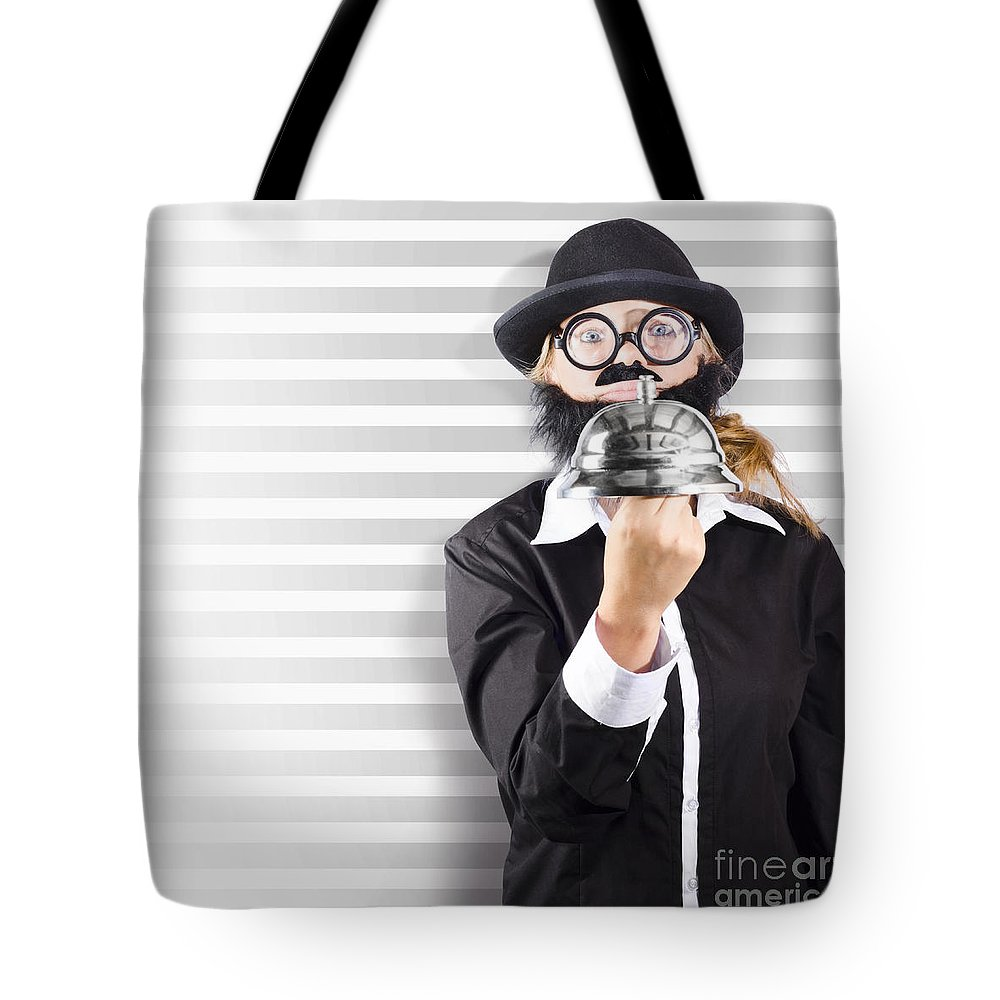 Aid Tote Bag featuring the photograph Comic Business Man Holding Big Service Bell by Jorgo Photography - Wall Art Gallery