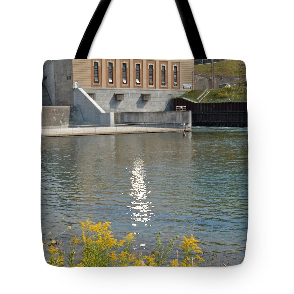 Sun Tote Bag featuring the photograph Dam Reflection by Susan Wyman
