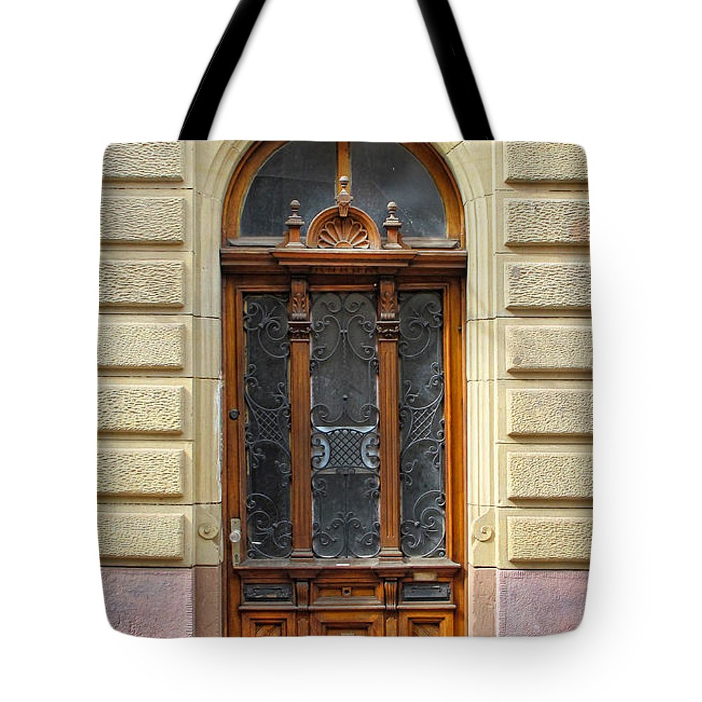 Door Tote Bag featuring the photograph Decorative Door by Dave Mills