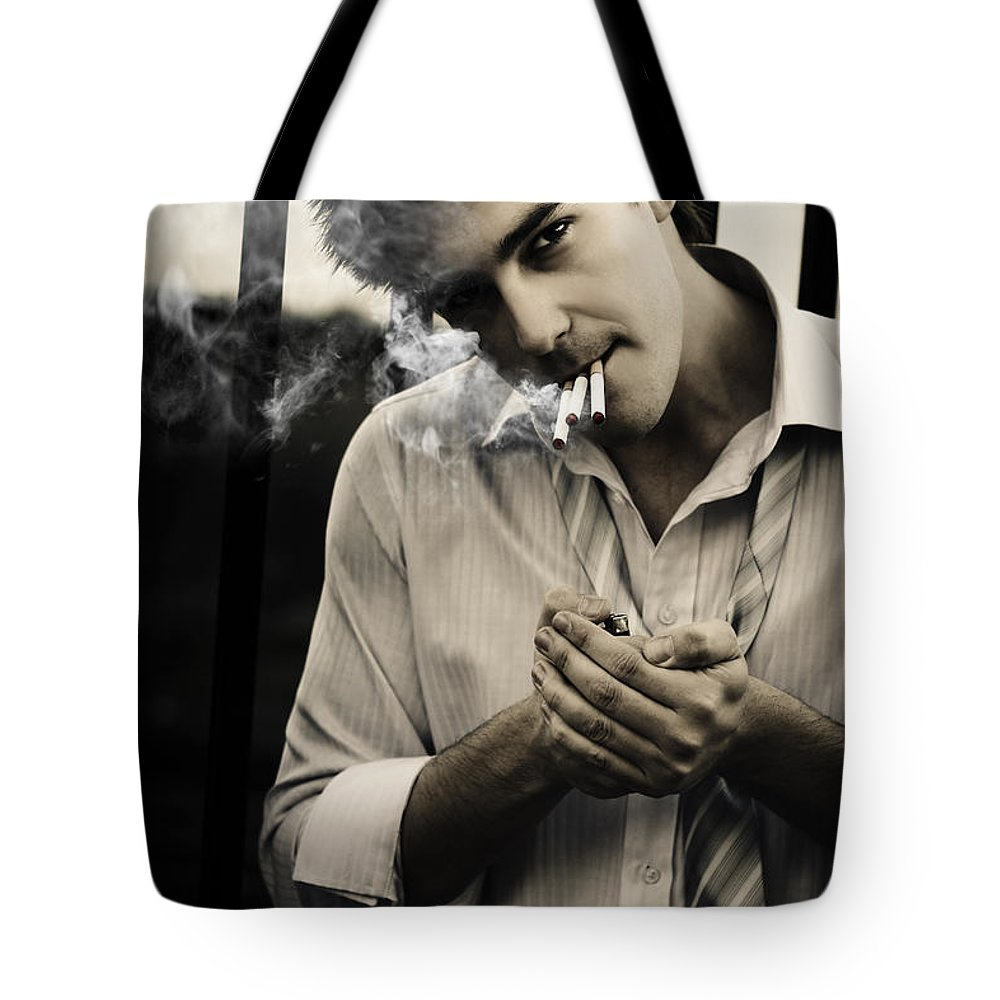 Person tote bag featuring the photograph depressed business man smoking 3 cigarettes by jorgo photography