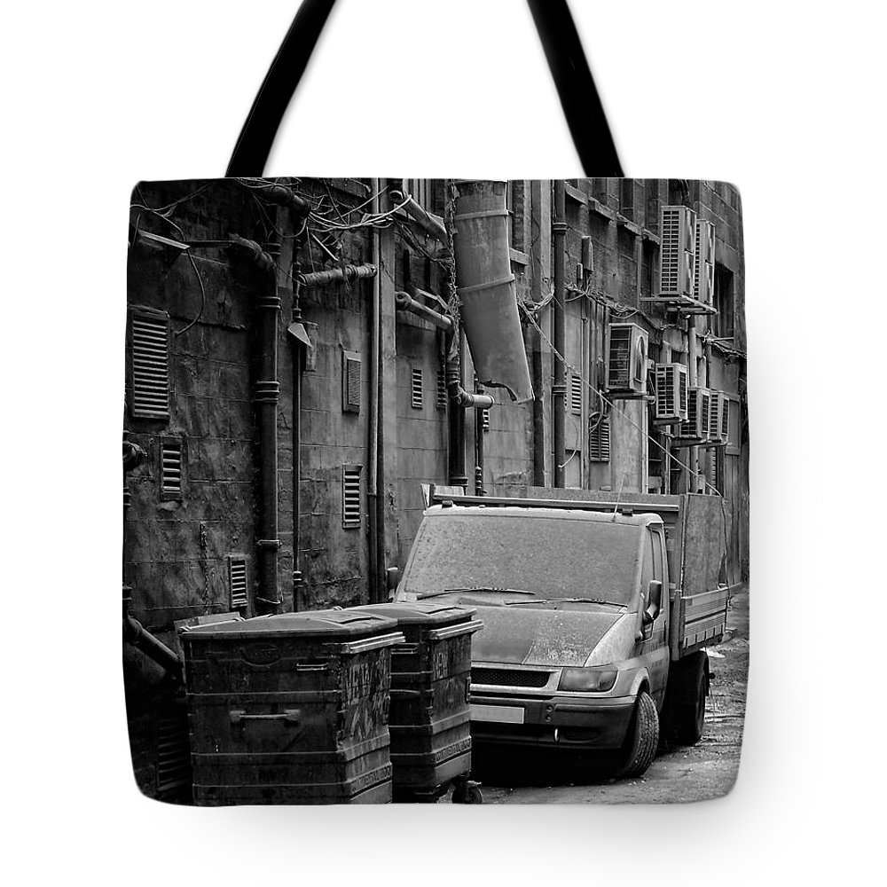 Black Tote Bag featuring the photograph Dirty Back Streets Mono by Antony McAulay