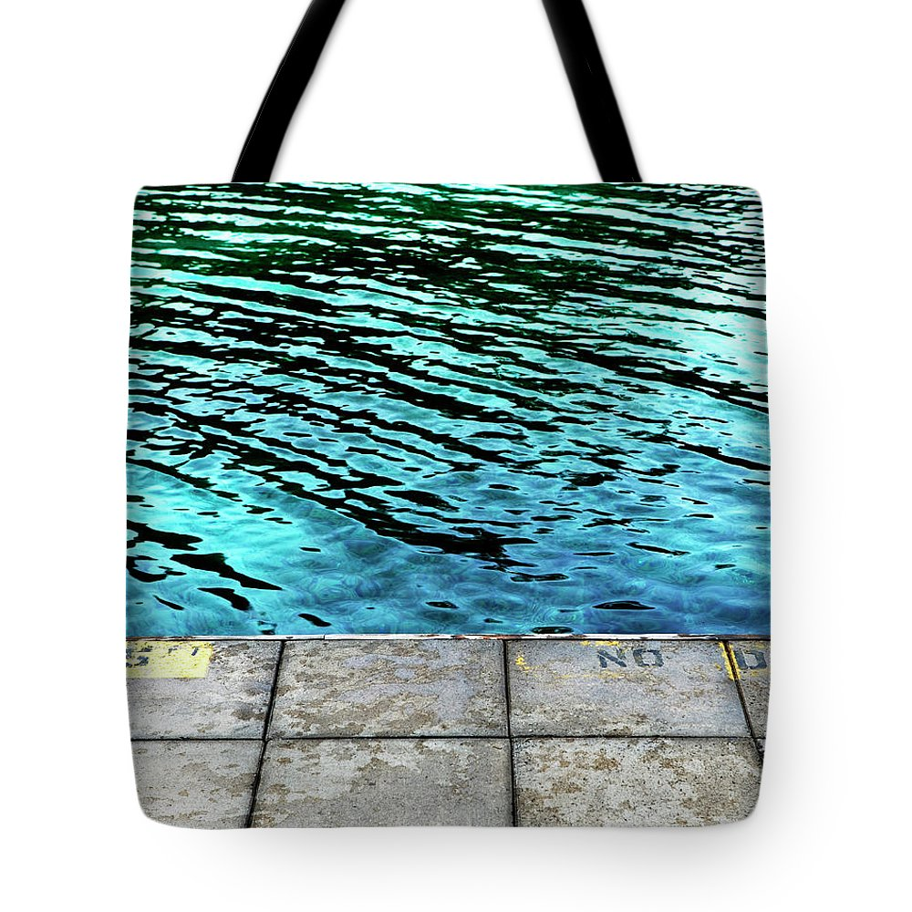 Absence Tote Bag featuring the photograph Empty Pier And River Water by Ron Koeberer