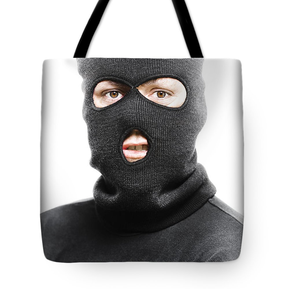Background Tote Bag featuring the photograph Face Of A Burglar Wearing A Ski Mask Or Balaclava by Jorgo Photography - Wall Art Gallery