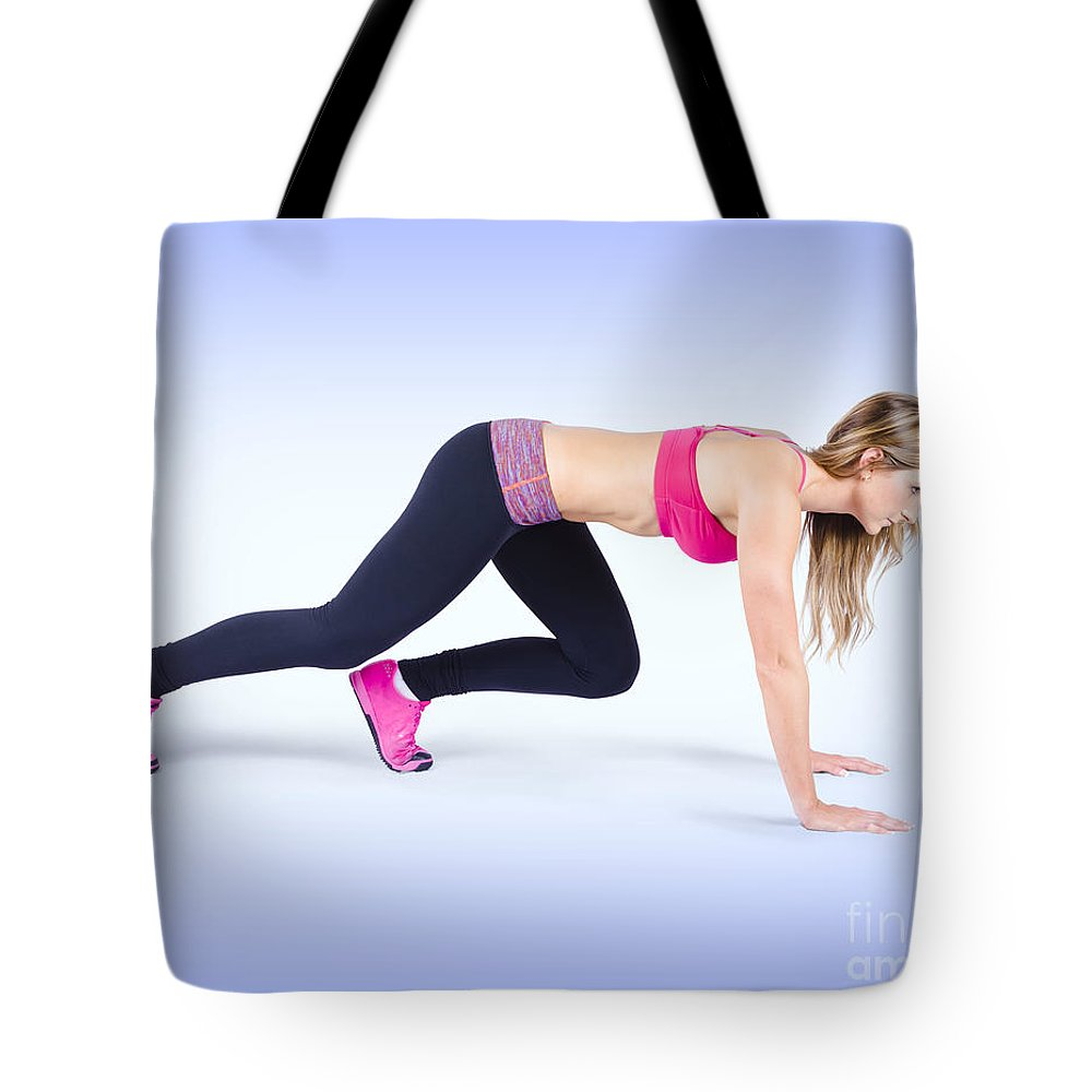 Active Tote Bag featuring the photograph Female Track And Field Athlete Preparing To Run by Jorgo Photography - Wall Art Gallery