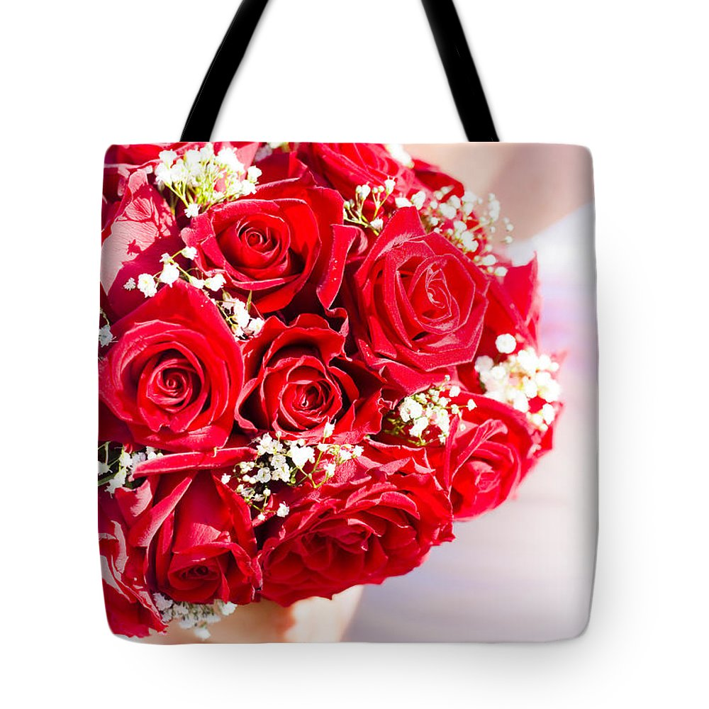 Red Tote Bag featuring the photograph Floral Rose Boquet Held By Bride by Jorgo Photography - Wall Art Gallery