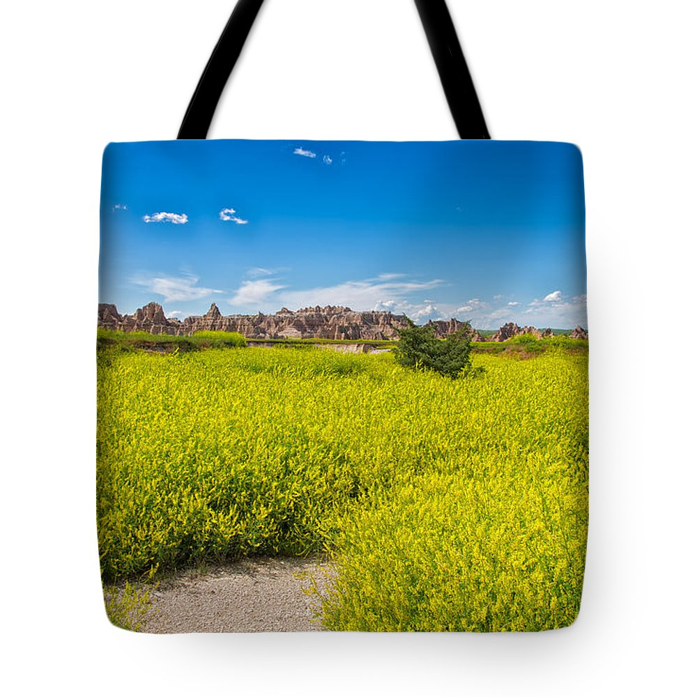 Landscape Tote Bag featuring the photograph Flowers In The Badlands by John M Bailey