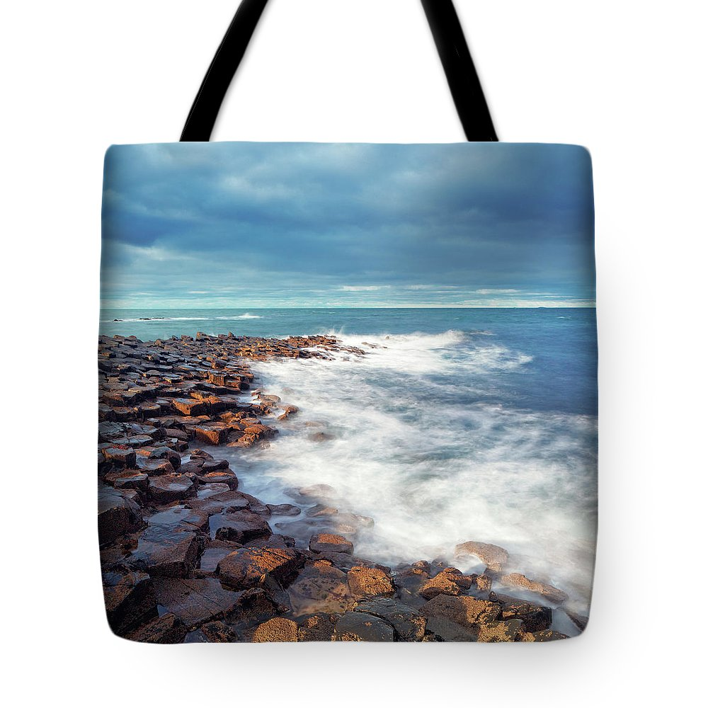 Water's Edge Tote Bag featuring the photograph Giants Causeway On A Cloudy Day by Mammuth