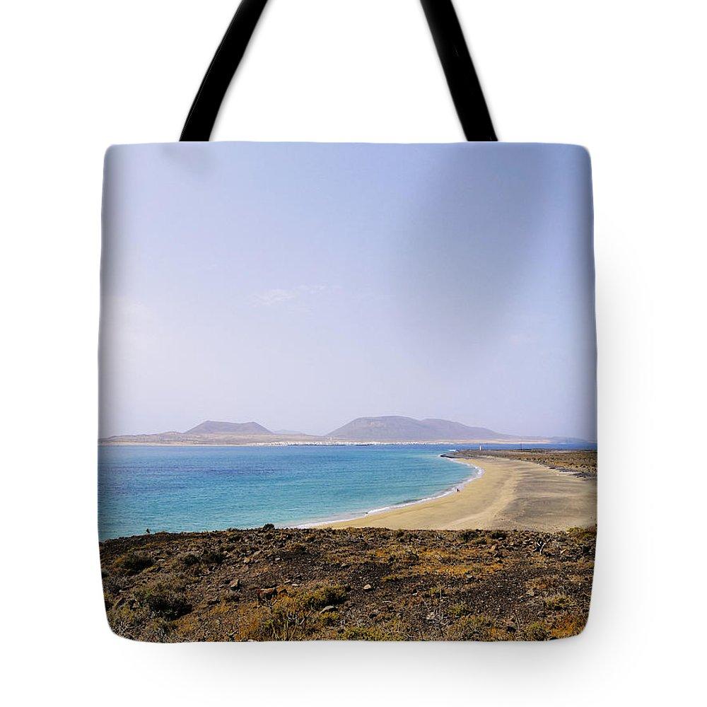Beach Tote Bag featuring the photograph Graciosa Island by Karol Kozlowski